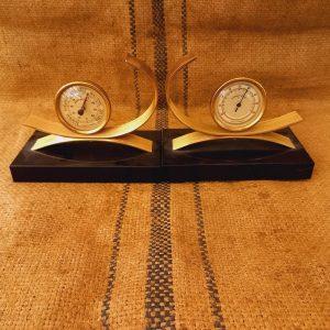 Serre-livres des années 40, socle marbre noir et métal doré. Baromètre-Thermomètre gold starry e